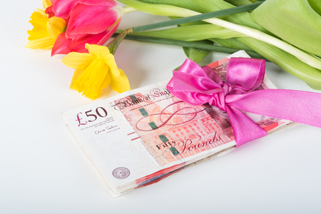 pounds: Stack of pounds associated with a pink ribbon