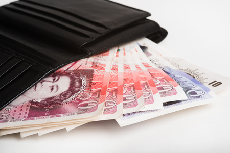 pounds: The European currency pounds in a black wallet. Stock Photo