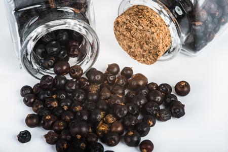 juniper: Wooden scoop with dried juniper berries