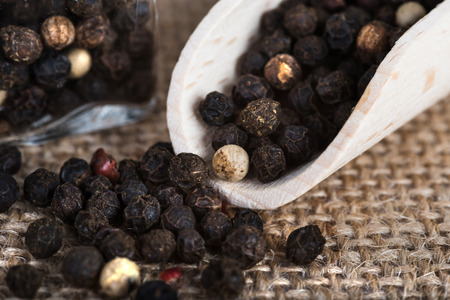 wooden scoop: Wooden scoop with dried pepper berries Stock Photo