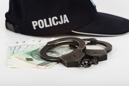 felon: In the picture handcuffs, money and police. Stock Photo