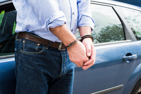 felon: Photo of man in handcuffs. Stock Photo