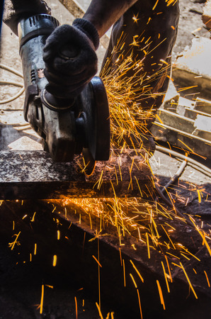 steel beam: The picture shows a man crossing a steel beam. Stock Photo
