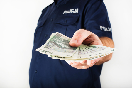corrupt: A corrupt policeman taking bribe