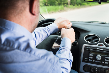 doldrums: A man drinking alcohol in the car. Stock Photo