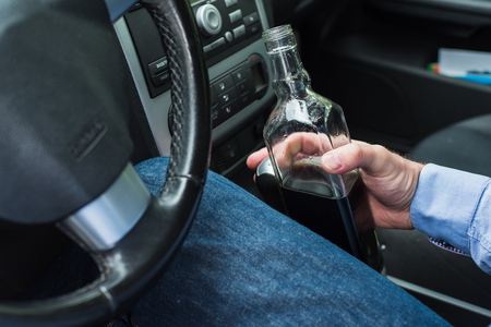 dejection: A man drinking alcohol in the car. Stock Photo