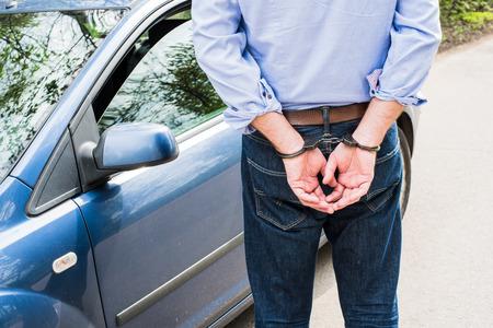 Photo of man in handcuffs. 版權商用圖片