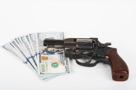 felony: The photo dollars, handcuffs and gun.