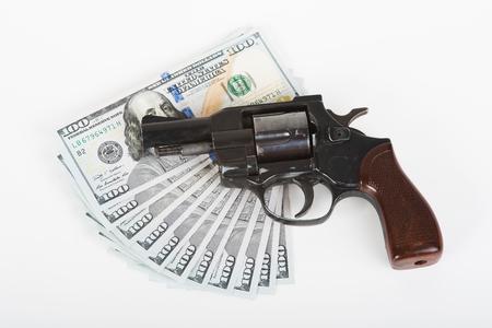 The photo dollars, handcuffs and gun.