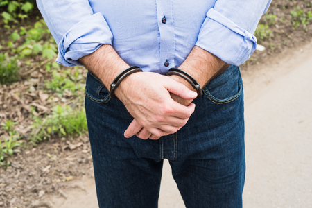 bussinessman: Photo of man in handcuffs. Stock Photo