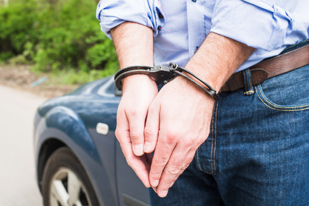 Photo of man in handcuffs. Stock Photo