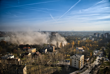 The next stages of the demolition of an office building in the center of dynamite. Stock Photo