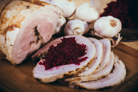 Bacon baked in the oven with spices and beets. Stock Photo