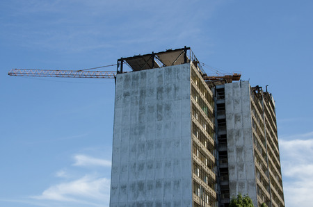 The photo shows the demolition of a skyscraper in the city center. Stock Photo