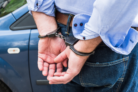 handcuffs: The man, a businessman in handcuffs.Arrest on the way.