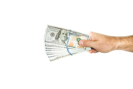 Dollars held in a male hand on a white background. A handful clamped with money.