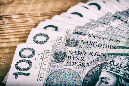 Polish currency PLN, money. File ,roll of banknotes of 100 PLN (Polish zloty)
