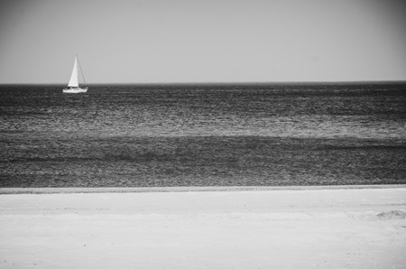 Black and white landscape Polish sea of breakwaters and sand dunes.