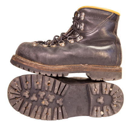 travelled: Old black boots trekking production of the USSR, isolated on a white background.