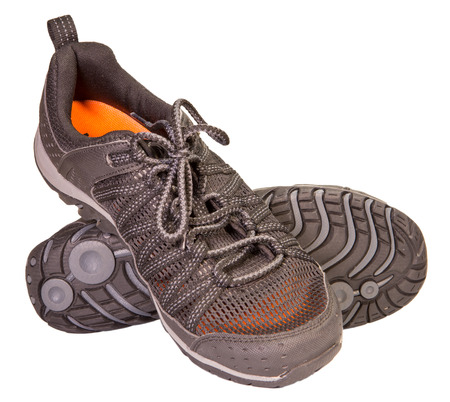 breathable: Tracking sporting black sneakers, breathable material, isolated on a white background. Stock Photo