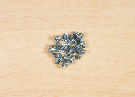 fastening: Elements of fastening pieces of furniture on a wooden background.