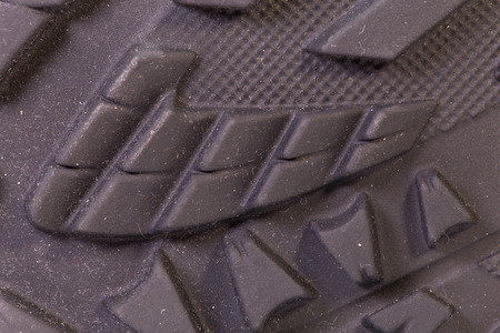 Detail of trekking shoes. The sole with tread. Stock Photo
