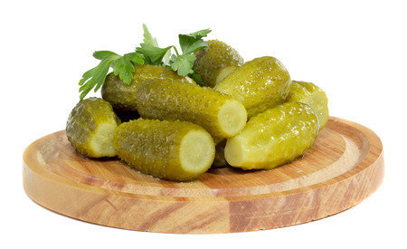 Pickles on the wooden plate isolated on white background Stock Photo - 25223211