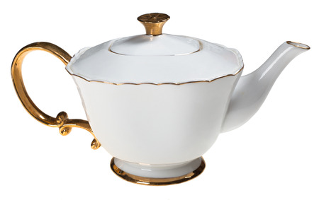 Elegant white and gold teapot isolated on white background photo