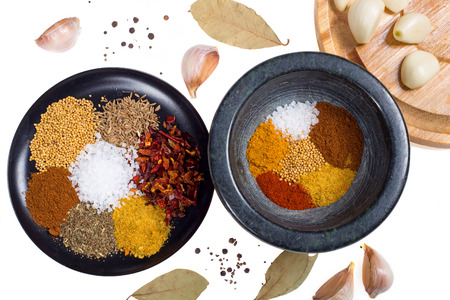 various spices on white background photo
