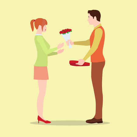 A man gives his girlfriend flowers and a box of chocolates. A loving couple on Valentine's Day exchange gifts.