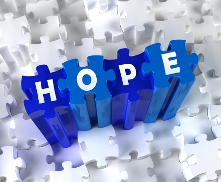 Creative 3D pieces of puzzle and word Hope photo