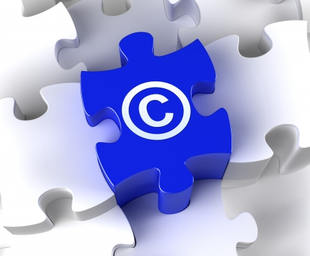 Creative 3D pieces of puzzle and copyright symbol