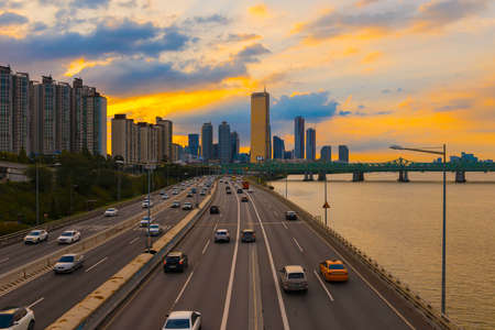 Traffic during sunset at Han river and Building 63 in Seoul,South Korea.