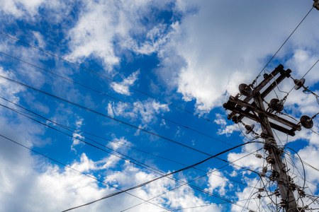 electricity post with cloud and blue sky