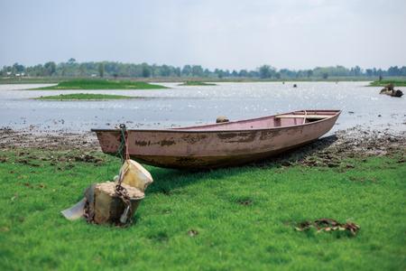 rowboat inside on river or bank