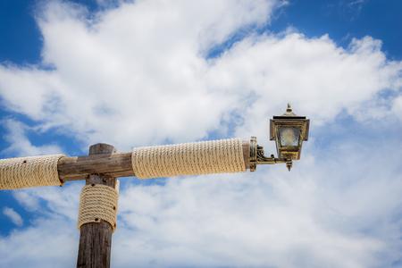 Lamp on the lamp post that wrap rope. 免版税图像