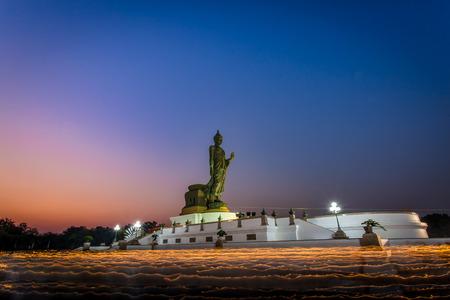 Triple Circumambulation Buddha statue in Magha Puja Day at Phutthamonthon district, Nakhon Pathom, Thailand.