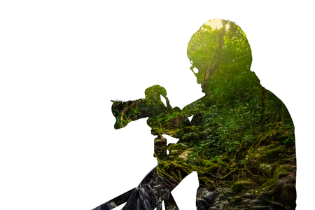Double exposure portrait of photographer combined with photograph of tree. Be creative!