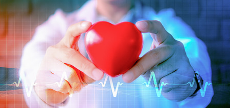abstract background of hands holding heart model with symbol of heart pulse signal Zdjęcie Seryjne