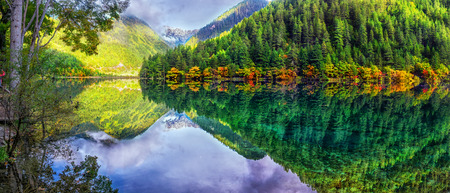 The panoramic colorful scenery of the mirror lake and forest at Jiuzhaigou national park