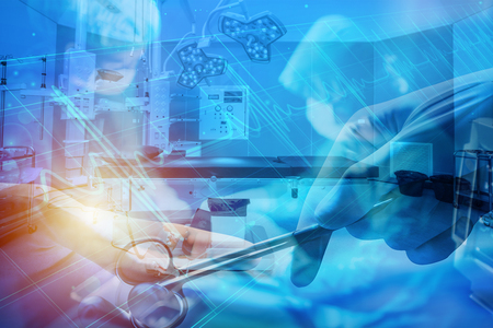double exposure abstract background with flare of operation activities in operation room Stock Photo