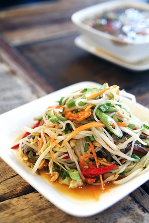 unripened: Som tam, a spicy salad made from shredded unripened papaya