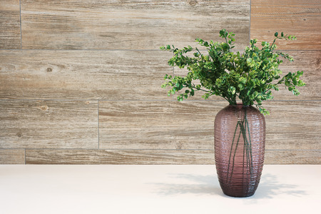 home accents: Tree on the vase wood backgrouds.