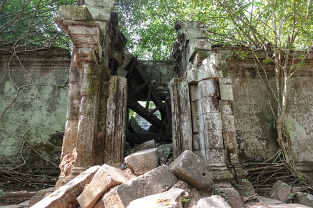 Outside the wall of the collapsed door of Bayon Temple at Angkor Thom.  On top view of the Angkor Thom within the temple area at the Angkor Temple complex  in a summer day near Siem Reap, Cambodia.