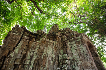 Old small castle covered with boiled wood of Bayon Temple at Angkor Thom.  On top view of the Angkor Thom within the temple area at the Angkor Temple complex  in a summer day near Siem Reap, Cambodia.