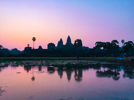 Pink Silhouette Angkor Wat Temple with Rising Sun. Best time in the morning a popular view tourist attraction ancient temple complex Silhouette Angkor Wat with reflected in lake Siem Reap, Cambodia.