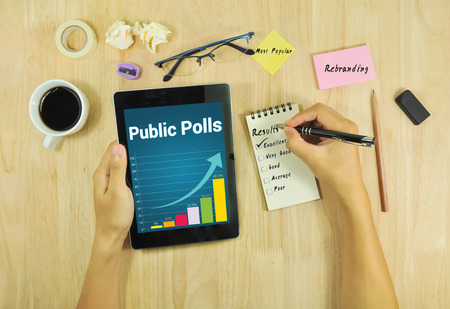 polls: Business looking public polls  rebranding on tablet .
