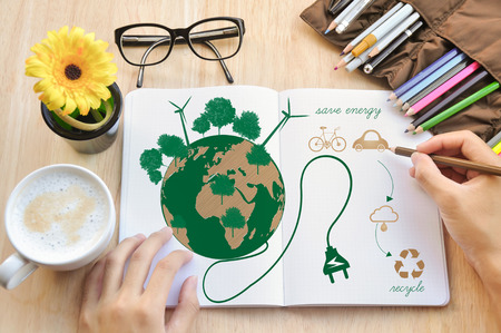 environment friendly: Hand write Notebook love earth concept.