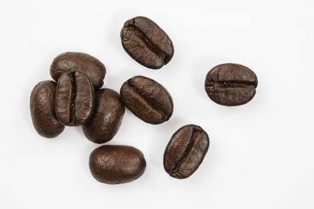 coffee harvest: coffee beans isolated on white background. Stock Photo