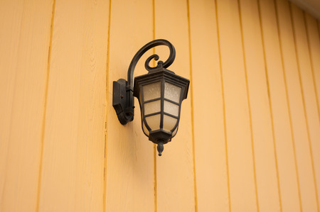 lamplight: Antique Outdoor Wall Lamp.